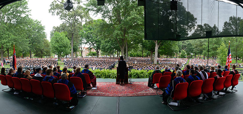 View of the grove during graduation from behind the speaker's podium